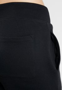 Champion - CUFF PANTS - Verryttelyhousut - black - 3