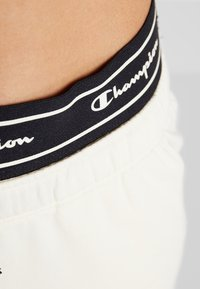 Champion - CUFF PANTS - Pantalon de survêtement - off-white - 3