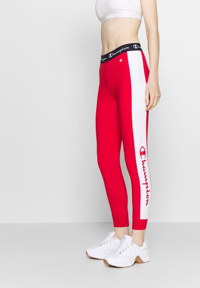 PANTS - Verryttelyhousut - red