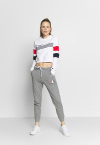 Champion - CUFF PANTS - Tracksuit bottoms - grey - 1