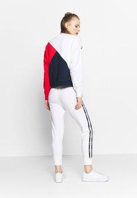 Champion - RIB CUFF PANTS - Pantalones deportivos - white - 2
