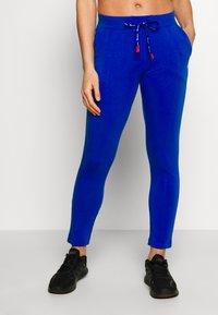 Champion - SLIM PANTS - Teplákové kalhoty - blue - 0