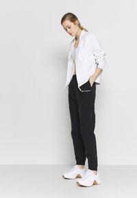 Champion - ELASTIC CUFF PANTS - Teplákové kalhoty - black - 1
