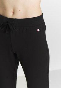 Champion - RIB CUFF PANTS - Spodnie treningowe - black - 4