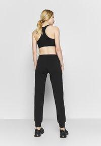 Champion - RIB CUFF PANTS - Spodnie treningowe - black - 2