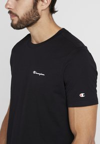 Champion - CREWNECK - T-shirt - bas - black - 4