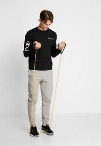 Champion - LONG SLEEVE - T-shirt à manches longues - black - 1