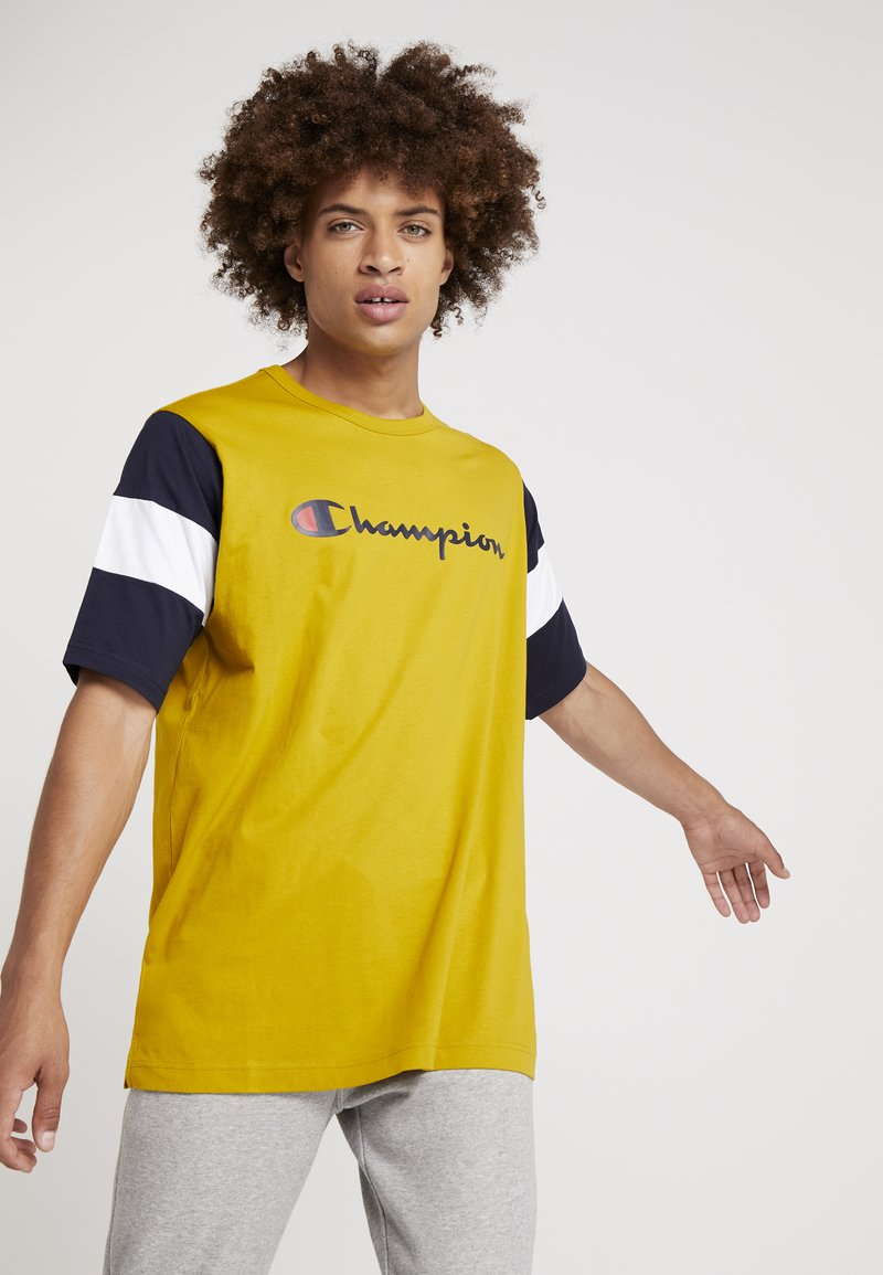 Champion - CREWNECK - Print T-shirt - dark yellow