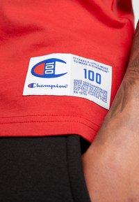Champion - TEE 100TH ANNIVERSARY - T-shirt print - dark red - 6