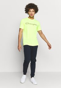 Champion - QUIK DRY  - Camiseta estampada - yellow - 1