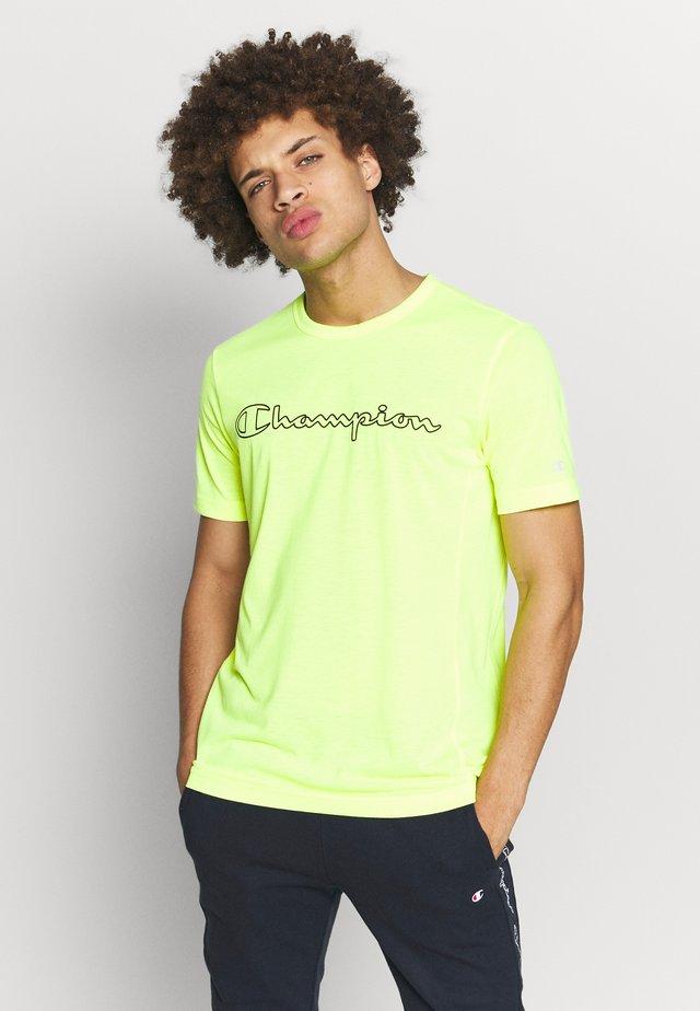 QUIK DRY  - T-shirt z nadrukiem - yellow