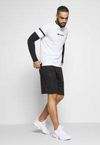 Champion - ROCHESTER ATHLEISURE - T-shirt con stampa - white - 1