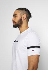 Champion - ROCHESTER ATHLEISURE - T-shirt con stampa - white - 3