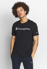 Champion - CREWNECK  - Print T-shirt - black - 0