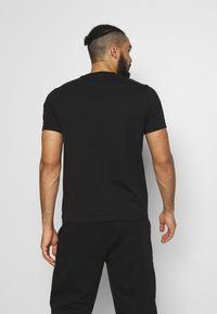 Champion - ROCHESTER BIG CREWNECK - Camiseta estampada - black - 2