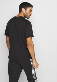 Champion - ROCHESTER WORKWEAR CREWNECK  - T-shirt con stampa - black - 2