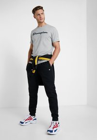 Champion - CUFF PANTS - Tracksuit bottoms - black - 1
