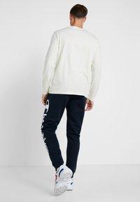 Champion - CUFF PANTS - Pantalon de survêtement - dark blue - 2