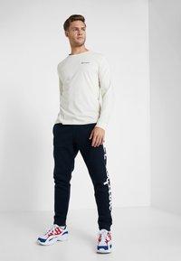 Champion - CUFF PANTS - Pantalon de survêtement - dark blue - 1