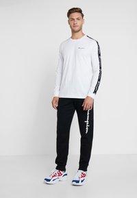 Champion - CUFF PANTS - Pantalon de survêtement - black - 1