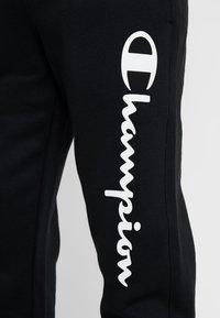 Champion - CUFF PANTS - Pantalon de survêtement - black - 3