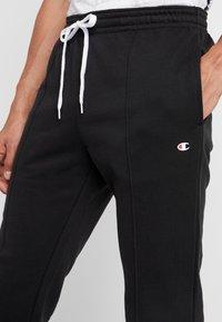 Champion - CUFF PANTS - Teplákové kalhoty - black - 4