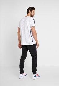Champion - CUFF PANTS - Pantalon de survêtement - black - 2