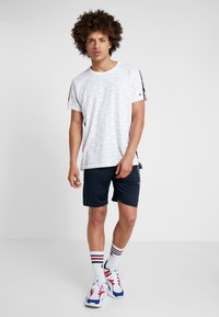Champion - RUN BERMUDA - Sports shorts - dark blue - 1