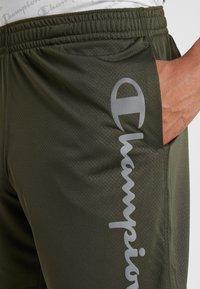 Champion - RUN BERMUDA - Sports shorts - dark green - 4