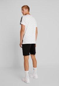 Champion - RUN BERMUDA - Sports shorts - black - 2