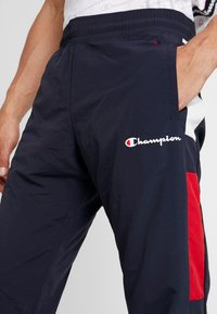 Champion - HALF BUTTON PANT - Pantalon de survêtement - night/white/heather - 4