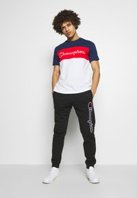 Champion - ROCHESTER CUFF PANTS - Teplákové kalhoty - black - 1