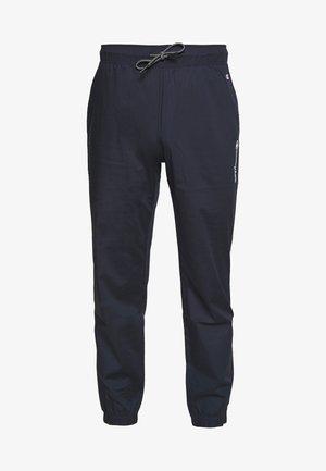 ELASTIC CUFF PANTS - Verryttelyhousut - dark blue
