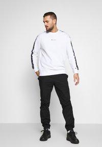 Champion - ELASTIC CUFF PANTS - Pantalon de survêtement - black - 1