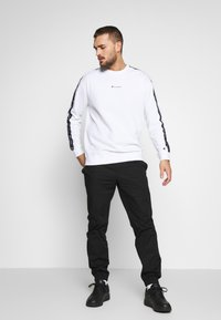 Champion - ELASTIC CUFF PANTS - Spodnie treningowe - black - 1