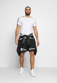 Champion - BIG LOGO BERMUDA - Sports shorts - black - 1