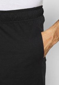 Champion - BIG LOGO BERMUDA - Sports shorts - black - 5