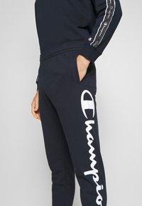 Champion - BIG LOGO CUFF PANTS - Verryttelyhousut - dark blue - 4