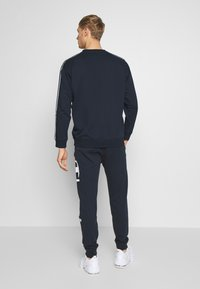 Champion - BIG LOGO CUFF PANTS - Verryttelyhousut - dark blue - 2