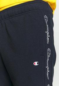 Champion - TAPE PANTS - Verryttelyhousut - dark blue - 4