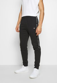 Champion - TAPE PANTS - Spodnie treningowe - black - 0