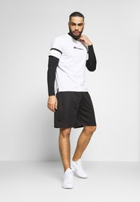 Champion - ROCHESTER ATHLEISURE - Sports shorts - black - 1