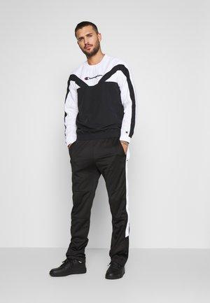 BREAKAWAY PANTS - Pantalones deportivos - black