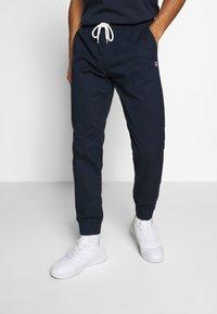 Champion - ROCHESTER ELASTIC CUFF PANTS - Trainingsbroek - dark blue - 0