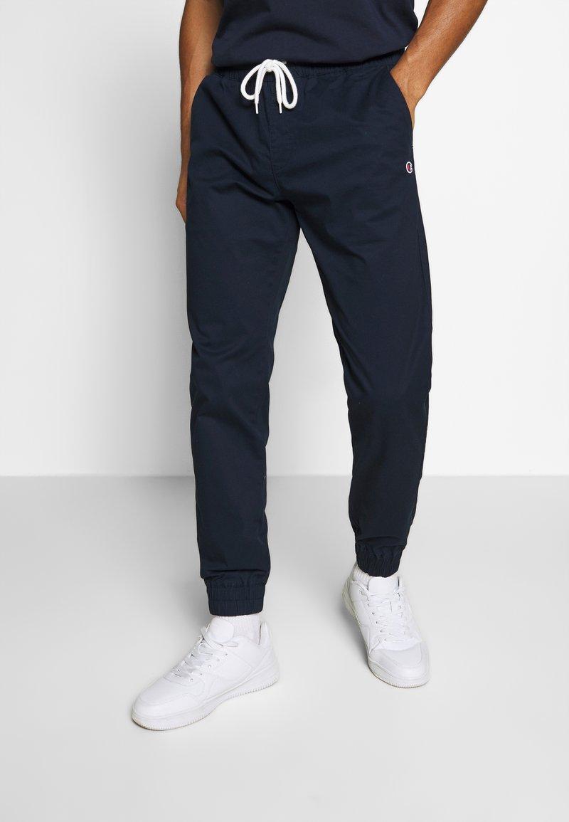Champion - ROCHESTER ELASTIC CUFF PANTS - Trainingsbroek - dark blue