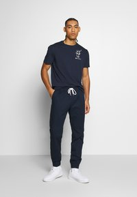 Champion - ROCHESTER ELASTIC CUFF PANTS - Trainingsbroek - dark blue - 1