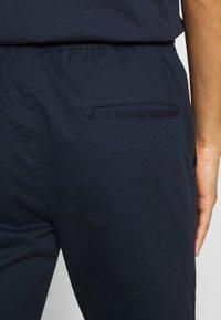 Champion - ROCHESTER ELASTIC CUFF PANTS - Trainingsbroek - dark blue - 4