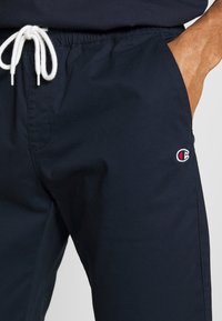 Champion - ROCHESTER ELASTIC CUFF PANTS - Trainingsbroek - dark blue - 6