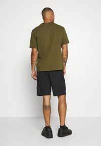 Champion - GET ON TRACK SHORT - Pantalón corto de deporte - black - 2