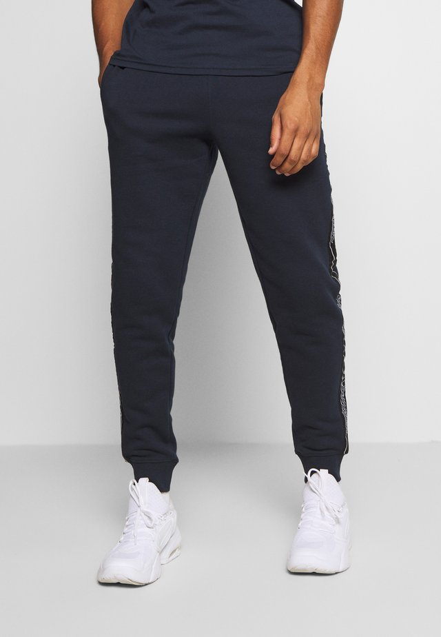 LEGACY TAPE CUFFED PANTS - Tracksuit bottoms - dark blue
